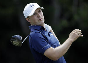 Photo - Jordan Spieth follows his shot from the seventh tee during the third round of The Players championship golf tournament at TPC Sawgrass, Saturday, May 10, 2014, in Ponte Vedra Beach, Fla. (AP Photo/Gerald Herbert)