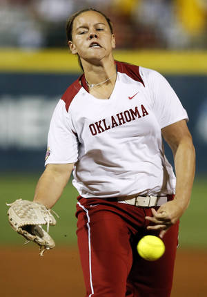 Photo - OU's Keilani Ricketts (10) pitches during an NCAA softball game in the Women's College World Series between Oklahoma and Michigan at ASA Hall of Fame Stadium, Thursday, May 30, 2013. Photo by Nate Billings, The Oklahoman