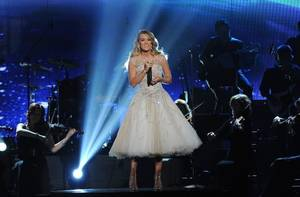 """Photo - : Checotah native Carrie Underwood performs on """"ACM Presents: An All-Star Salute to the Troops."""" (AP)"""