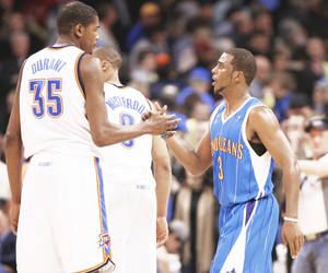 Photo - After Saturday's win at Golden State, Kevin Durant and the Thunder are in seventh place in the Western Conference. But Chris Paul, right, and the Hornets made similar playoff runs when they were in Oklahoma City only to come up short. PHOTO BY BRYAN TERRY, THE OKLAHOMAN