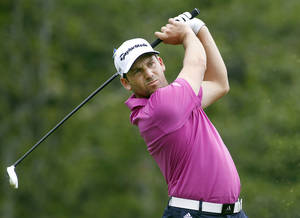 Photo - Sergio Garcia, from Spain, tees off on the 17th hole during the second round of the Deutsche Bank Championship golf tournament in Norton, Mass., Saturday, Aug. 31, 2013. (AP Photo/Stew Milne)