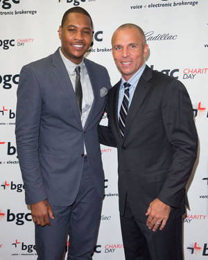 Photo - Carmelo Anthony, left, and Jason Kidd arrives at the Annual Charity Day hosted by Cantor Fitzgerald and BGC Partners, on Wednesday, Sept. 11, 2013 in New York. (Photo by Ben Hider/Invision/AP)