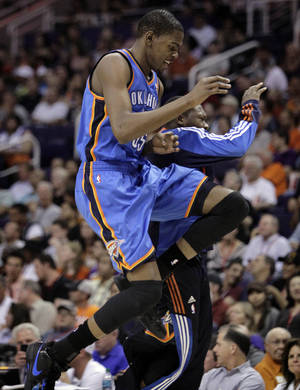 Photo - Thunder forward Kevin Durant celebrates during Wednesday's win. AP photo