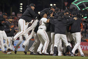 Photo -   The San Francisco Giants celebrate their 8-4 win over the San Diego Padres in a baseball game Saturday, Sept. 22, 2012, in San Francisco. The Giants captured the NL West title. (AP Photo/San Francisco Chronicle, lance Iversen) MANDATORY CREDIT MAGS OUT NO SALES TV OUT