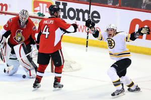 photo - Boston Bruins' Dennis Seidenberg, left, celebrates his winning goal against the Ottawa Senators with Patrice Bergeron (37), Tyler Sequin (19) and Zdeno Chara (33) during the third period of their NHL hockey game, Thursday, March 21, 2013, in Ottawa, Ontario. The Bruins won 2-1. (AP Photo/The Canadian Press, Fred Chartrand)
