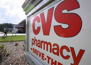 Photo - Customers take advantage of the drive-thru pharmacy window outside a CVS drugstore in a Bainbridge Township, Ohio. AP Photo