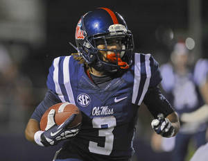 Photo - Mississippi running back Jeff Scott (3) rushes for a first down during the first half of NCAA college football game against Texas A&M on Saturday, Oct. 12, 2013, in Oxford, MS. #9 Texas A&M won 41-38. (AP Photo/ The Daily Mississippian, Austin McAfee)