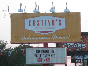 Photo - The sign in front of Custino's Italian Restaurant is shown. Photo by Steve Lackmeyer,  The Oklahoman