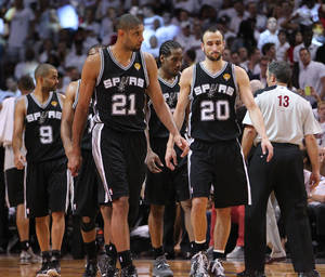 Photo - From left, San Antonio Spurs basketball players Tony Parker (9),  Tim Duncan (21) and Manu Ginobili (20) are shown in the fourth quarter of their Game 7 loss to the Miami Heat in the NBA Finals in Miami, early Friday, June 21, 2013.   (AP Photo/El Nuevo Herald, David Santiago) MAGS OUT