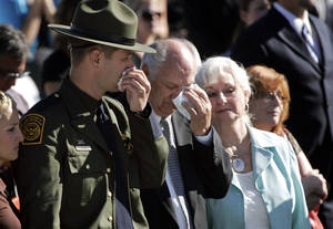 photo -   Hundreds gathered at the funeral for U.S. Border Patrol agent Nicholas Ivie on Monday October 8, 2012 in Sierra Vista, Ariz., including brother and fellow agent Joel Ivie, left, and father and stepmother Doug and Donetta Ivie. (AP Photo/Arizona Daily Star, Benjie Sanders) ALL LOCAL TV OUT; PAC-12 OUT; MANDATORY CREDIT