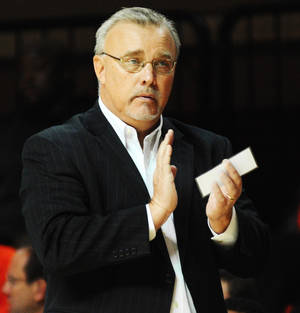 Photo - Oklahoma State coach Jim Littell claps after a made basket during the Oklahoma State womens' basketball game versus Southern California on Nov. 22, 2013 at Gallagher Iba Arena in Stillwater, Okla. Photo by KT King/For the Oklahoman
