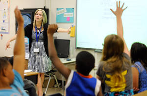 Photo - Amy Lawson, a fifth-grade teacher at Silver Lake Elementary School in Middletown, Del., teaches an English language arts lesson Tuesday, Oct. 1, 2013. The school has begun implementing the national Common Core State Standards for academics. (AP Photo/Steve Ruark)