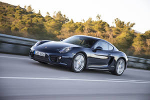 Photo - This undated photo provided by Porsche shows the 2014 Porsche Cayman. Porsche, Jaguar and Lexus were the best-performing brands in this year's J.D. Power quality rankings survey. (AP Photo/Porsche)