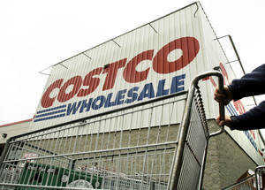 Photo - FILE - A shopper pushes a cart outside Costco Wholesale in Danvers, Mass. in this May 27, 2009 file photo. Costco's fiscal second-quarter net income fell 15 percent, hurt by softer sales of some non-food items, weaker gross margins in its fresh foods business and the impact of weaker foreign currency exchange rates on its international results. Its latest performance missed Wall Street's view. The stock declined in premarket trading on Thursday March 6, 2014. (AP Photo/Elise Amendola, File)