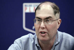 photo - FILE - In this Nov. 28, 2012 file photo, baseball union head Michael Weiner speaks during a news conference in New York. Weiner says, Monday Feb. 25, 2013,  there's active discussion about increasing the penalties for violating baseball's drug testing program. Weiner says players have very little patience for seeing their peers try to cheat the system.  (AP Photo/Frank Franklin II, File)