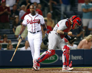 Photo - St. Louis Cardinals catcher Yadier Molina (4) pumps his fist after Atlanta Braves left fielder Justin Upton (8) struck out for the final out in the 9th inning of a baseball game Monday, May 5, 2014 in Atlanta.  St. Louis won 4-3. (AP Photo/John Bazemore)