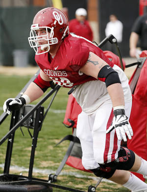 Photo - COLLEGE FOOTBALL: Offensive lineman Bronson Irwin participates in Sooner spring football drills at University of Oklahoma (OU) on Tuesday, March 12, 2013 in Norman, Okla.  Photo by Steve Sisney, The Oklahoman