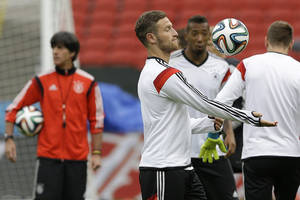 Photo - Germany's soccer team player Shkodran Mustafi bounces the ball off his arm during a training session at the Estadio Beira-Rio Stadium in Porto Alegre, Brazil, Sunday, June 29, 2014. Germany will play Algeria in a World Cup round of 16 soccer match on June 30. (AP Photo/Kirsty Wigglesworth)