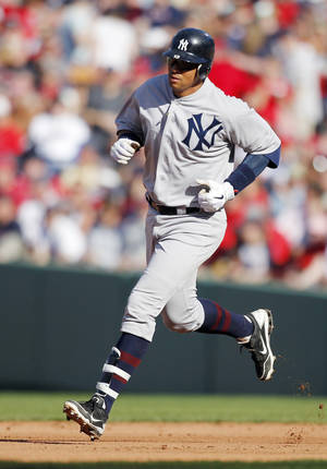 Photo -   New York Yankees' Alex Rodriguez rounds the bases on a solo home run in the fifth inning of a baseball game against the Boston Red Sox in Boston, Friday, April 20, 2012. (AP Photo/Michael Dwyer)