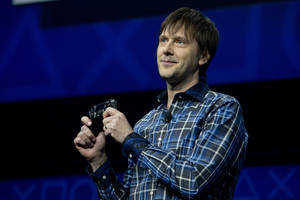 photo - Mark Cerny, lead system architect for the Sony Playstation 4 speaks during an event to announce the new video game console, Wednesday, Feb. 20, 2013, in New York.  (AP Photo/Frank Franklin II)