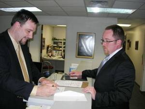 Photo - State Election Board Secretary Paul Ziriax, left, goes over filing papers Wednesday with Kenneth Meador, a Democratic candidate for the Senate District 43 seat. <strong>Michael McNutt - THE OKLAHOMAN</strong>