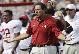 Photo - Alabama head coach Nick Saban reacts on the sideline during the second quarter of an NCAA college football game against Texas A&M Saturday, Sept. 14, 2013 in College Station, Texas. (AP Photo/David J. Phillip)