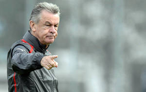 "Photo -   Swiss national soccer coach Ottmar Hitzfeld observes a practice session of his squad in Freienbach, Switzerland Sunday Oct. 14, 2012. FIFA has asked its disciplinary committee to consider action against Switzerland coach Ottmar Hitzfeld for an apparent offensive gesture toward the referee during a World Cup qualifier. Swiss media published images of Hitzfeld making a hand gesture in the first half of a 1-1 draw with Norway in Bern on Friday. Hitzfeld later expressed his frustration at decisions made by Spanish referee David Fernandez Borbalan. FIFA says its disciplinary panel ""will evaluate the case and define next steps."" (AP Photo/Keystone/Walter Bieri)"
