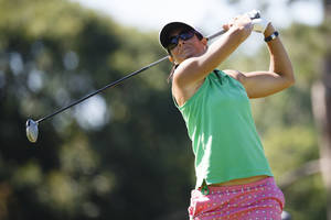 Photo - Laura Diaz tees off on the seventh hole during the the first round of the Marathon Classic LPGA golf tournament at Highland Meadows Golf Club in Sylvania, Ohio, Thursday, July 17, 2014. (AP Photo/Rick Osentoski)