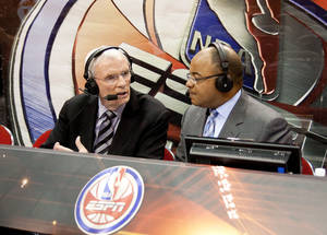 Photo - Thursday, May 6, 2010 -- Orlando, Fla. -- Amway Arena -- The NBA Playoffs on ESPN -- Commentators Hubie Brown (l) and Mike Tirico call the action for the Atlanta Hawks at Orlando Magic game