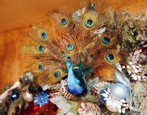 Photo - This peacock is part of the Christmas decor in the home of Scott Ellis at 2517 NW 12, one of six homes decorated for the historic Miller neighborhood's third annual Miller Mantels & Trees home tour.PHOTO BY PAUL HELLSTERN, The Oklahoman