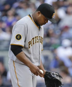Photo - Pittsburgh Pirates starting pitcher Edinson Volquez reacts after giving up a two-run home run to New York Yankees' Mark Teixeira during the first inning of a baseball game, Saturday, May 17, 2014, in New York. (AP Photo/Julie Jacobson)