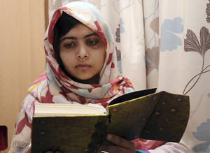 photo - FILE - In this undated file photo provided by Queen Elizabeth Hospital in Birmingham, England, Malala Yousufzai, the 15-year-old girl who was shot at close range in the head by a Taliban gunman in Pakistan, reads a book as she continues her recovery at the hospital. Malala on Friday Feb 8 2013  has been discharged from a British hospital where she had been receiving treatment for nearly four months.(AP Photo/Queen Elizabeth Hospital, File)