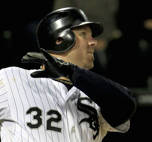 photo -   Chicago White Sox's Adam Dunn watches his three-run homer against the Cleveland Indians head for the wall during the eighth inning of a baseball game, Monday, Sept. 24, 2012, in Chicago. (AP Photo/John Smierciak)