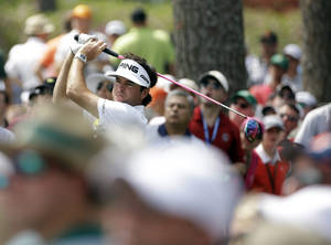 Photo - Bubba Watson tees off on the 17th hole during the second round of the Masters golf tournament Friday, April 11, 2014, in Augusta, Ga. (AP Photo/David J. Phillip)