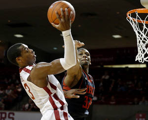 photo - OU: Oklahoma&#039;s Buddy Hield (3) goes to the basket beside Texas Tech&#039;s Jordan Tolbert (32) during an NCAA college basketball game between the University of Oklahoma and Texas Tech University at Lloyd Noble Center in Norman, Okla., Wednesday, Jan. 16, 2013. Photo by Bryan Terry, The Oklahoman