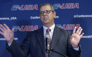 Photo - Conference USA commissioner Britton Banowsky speaks at the NCAA college Conference USA football media day in Irving, Texas Wednesday, July 23, 2014.  Banowsky seems to be settling in after a few years of significant change in the makeup of its league, at the same time the five power conferences seem so close to the autonomy they have sought. (AP Photo)