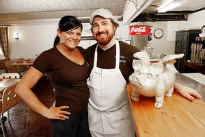 "Photo - Courtney and Josh Valentine at their Divine Swine Pork Bistro, which they closed so Josh could compete on ""Top Chef: Seatle,"" which premieres Nov. 7. <strong>STEVE GOOCH - THE OKLAHOMAN</strong>"