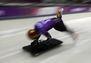Photo - John Daly of the United States starts his run during the men's skeleton training at the 2014 Winter Olympics, Wednesday, Feb. 12, 2014, in Krasnaya Polyana, Russia. (AP Photo/Dita Alangkara)