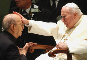 Photo - FILE - In this Nov. 30, 2004 file photo, Pope John Paul II gives his blessing to father Marcial Maciel, founder of the Legion of Christ, during a special audience at the Vatican. Pope Benedict XVI took over the Legion in 2010 after a Vatican investigation determined that Maciel had sexually molested seminarians and fathered three children by two women. Following a decision Thursday Feb. 14, 2013, by the Rhode Island Supreme Court, documents have been unsealed related to a lawsuit contesting the will of Gabrielle Mee, who left $60 million to the Legion. (AP Photo/Plinio Lepri, File)