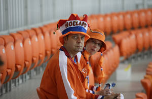 Photo - Dutch fans take their seat ahead of the women's 1,000-meter speedskating race at the Adler Arena Skating Center during the 2014 Winter Olympics in Sochi, Russia, Thursday, Feb. 13, 2014. (AP Photo/David J. Phillip )
