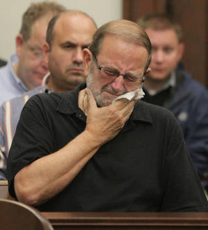 Photo -   Jack Kern reacts after a jury reached a guilty verdict on all accounts in the Brogan Rafferty Craigslist murder trial in the courtroom of Judge Lynn S. Callahan in the Summit County Courthouse on Tuesday, Oct. 30, 2012 in Akron, Ohio. Kern's son Timothy of Massillon was one of the men murdered. Rafferty, an Ohio teenager taken under the wing of a man defense attorneys described as a master manipulator was found guilty of aggravated murder Tuesday for his role in a deadly plot to lure men desperate for work with phony Craigslist job offers. (AP Photo/Akron Beacon Journal, Phil Masturzo, Pool)