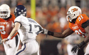 photo - OSU's Ugo Chinasa (91) and the rest of the defense will have their hands full with Texas A&M QB Jerrod Johnson. Photo by Sarah Phipps, The Oklahoman