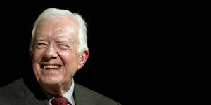 Photo - Former U.S. President Jimmy Carter speaks with Mark Updegrove, director of the Lyndon B. Johnson Presidential Library in Austin, on the first day of the Civil Rights Summit, Tuesday, April 8, 2014, in Austin, Texas. (AP Photo/Statesman.com, Ralph Barrera, Pool)