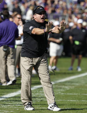 photo - TCU head coach Gary Patterson instructs his team in the first half of an NCAA college football game against Oklahoma, Saturday, Dec. 1, 2012, in Fort Worth, Texas. (AP Photo/Tony Gutierrez)