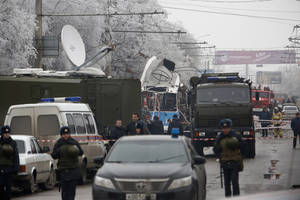 Photo - Military vehicles  surround a wreckage of a trolleybus, in Volgograd, Russia,  Monday, Dec. 30, 2013.  A bomb blast tore through a trolleybus in the city of Volgograd on Monday morning, killing at least 10 people a day after a suicide bombing that killed at least 17 at the city's main railway station. Volgograd is about 650 kilometers (400 miles) northeast of Sochi, where the Olympics are to be held. (AP Photo/Denis Tyrin)