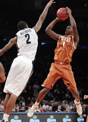 photo - Texas' Sheldon McClellan (1) shoots over Georgetown's Greg Whittington (2) during the second half of their NCAA college basketball game in the Jimmy V Classic at Madison Square Garden, Tuesday, Dec. 4, 2012, in New York. Georgetown won 64-41. (AP Photo/Frank Franklin II)