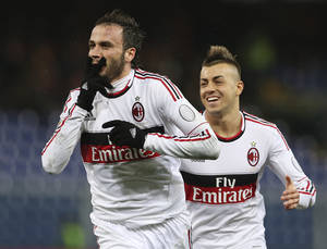 photo - AC Milan forward Giampaolo Pazzini, left, celebrates with his teammate forward Stephan El Shaarawy after scoring during the Serie A soccer match between Genoa and AC Milan at the Ferraris stadium in Genoa, Italy, Friday, March 8, 2013. (AP Photo/Antonio Calanni)
