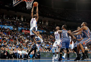 Photo - Oklahoma City Thunder's James Harden (13) scores during the second half of the NBA basketball game as the Oklahoma City Thunder defeat the Charlotte Bobcats at 122-95 at the Chesapeake Energy Arena in Oklahoma City, Saturday, March 10, 2012. Photo by Steve Sisney, The Oklahoman