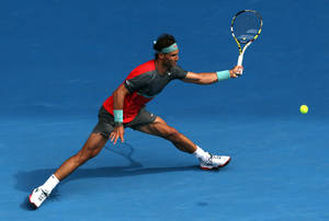 Photo - Rafael Nadal of Spain makes a forehand return to Kei Nishikori of Japan during their fourth round match at the Australian Open tennis championship in Melbourne, Australia, Monday, Jan. 20, 2014.(AP Photo/Eugene Hoshiko)