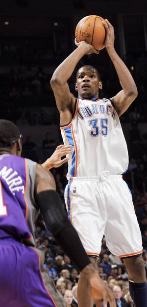 photo - Thunder forward Kevin Durant shoots during Oklahoma City's 104-102 loss to the Phoenix Suns on Tuesday at the Ford Center. PHOTO BY NATE BILLINGS, THE OKLAHOMAN